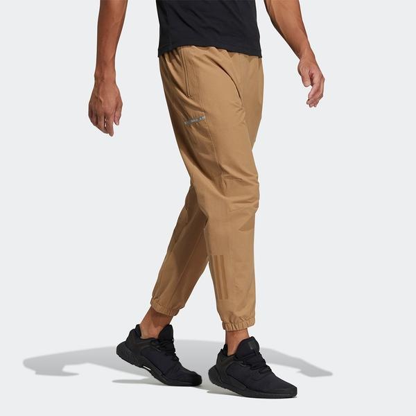 【現貨】Adidas TECH ID 男裝 長褲 休閒 調節腰帶 口袋 反光 縮口 卡其【運動世界】GP0959