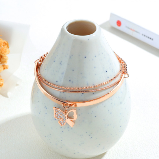 《 QBOX 》FASHION 飾品【B19N999】 精緻秀氣韓版層次鏈條蝴蝶流蘇鍍玫瑰金手鍊/手環