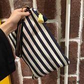 20韓版復古流蘇拉鏈條紋手拿包帆布