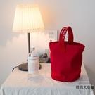 簡約帆布水桶包休閒百搭小手拎挽包隨身便攜飯盒袋手機包【時尚大衣櫥】