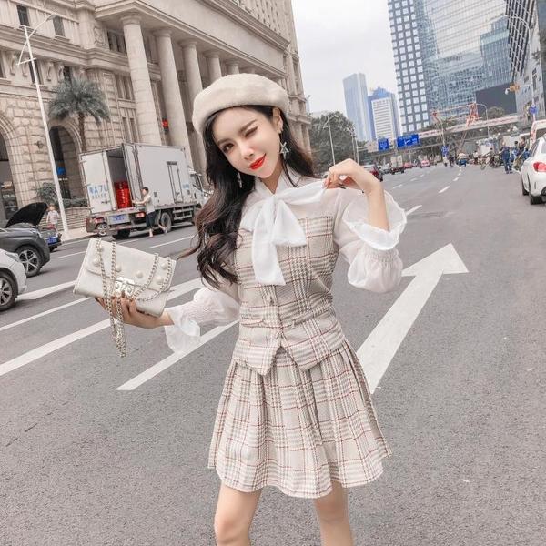 絕版出清 韓系蝴蝶結拼接百褶裙套裝長袖裙裝
