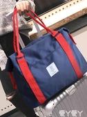 旅行包子手提行李包網紅側背短途帆布旅行包女大容量斜背收納包男新品