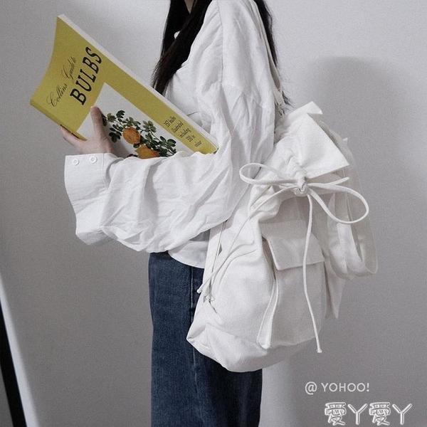 後背包 日韓黑白純色百搭單肩帆布包袋後背背包包學生書包男女 愛丫