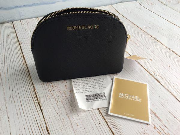 美國MICHAEL KORS  (MK)紋防刮 小貝殼造型 手拿包 黑色 **限時特價
