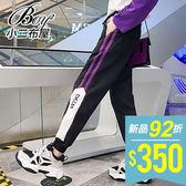 條紋雙線條運動休閒縮口褲【NQG95905】