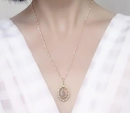 [協貿國際]天然菊花石鑲嵌橢圓形吊墜鍍24K金鍊單條價