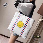 側背包 大包包女韓版文藝笑臉帆布包購  ~黑色地帶