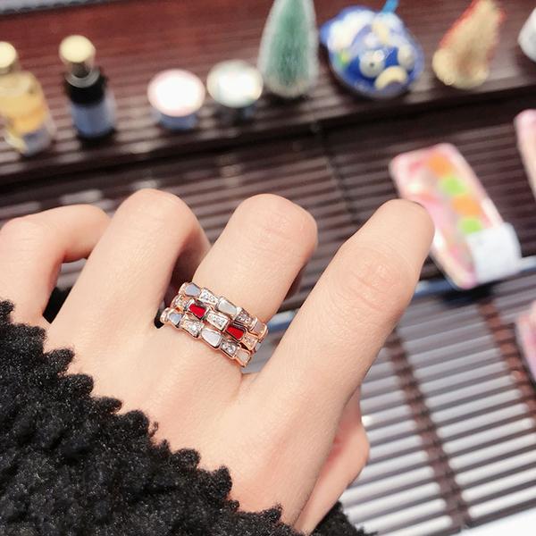 蛇形戒指鑲鑽女白貝母戒指鈦鋼鍍指環
