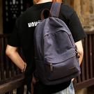 雙肩包男休閑帆布旅行背包初中高中大學生書包男女時尚潮流