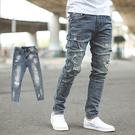 牛仔褲 韓國製洗舊刷色抓破抽鬚合身版牛仔...