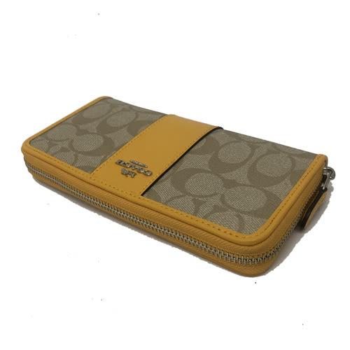 【COACH】立體金屬LOGO 直條紋ㄇ型拉鍊長夾(黃)