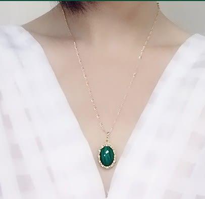 [協貿國際]天然孔雀石鑲嵌橢圓形吊墜鍍24K金單條價