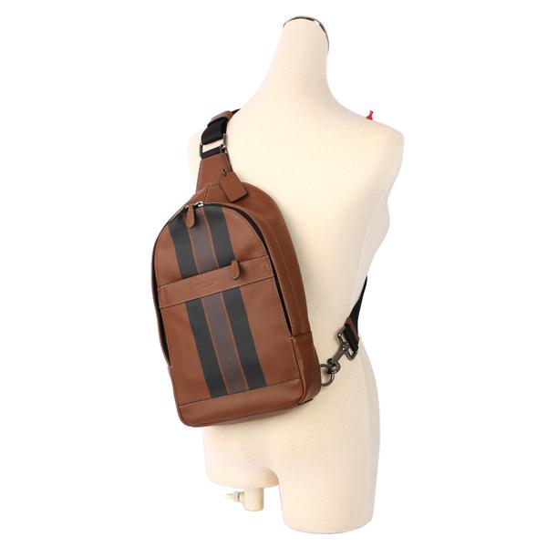 【COACH】焦糖皮革斜背包/胸口包(黑咖條紋)F72226 QBMFV
