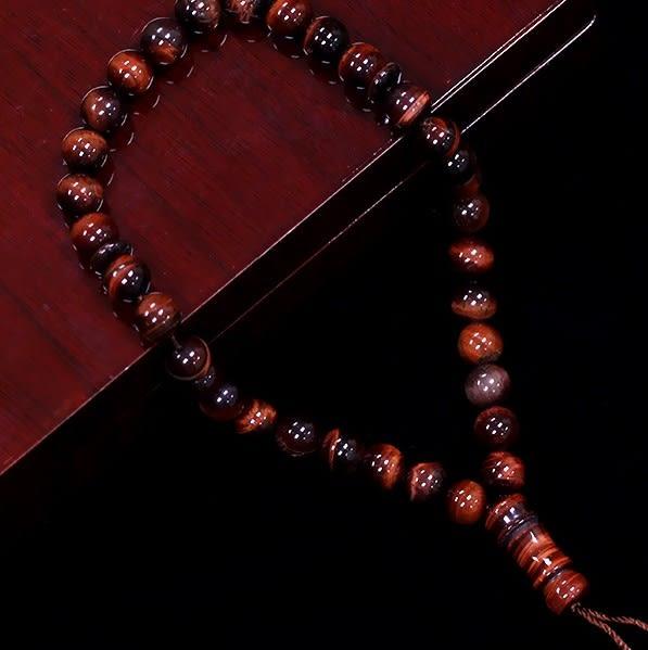 [協貿國際]天然紅虎石33顆念珠單個價