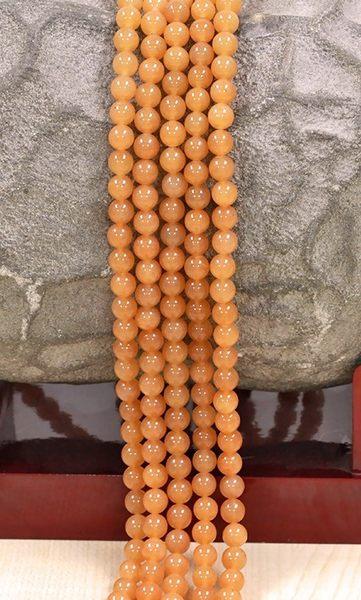 [協貿國際]天然紅東陵玉散珠14MM29顆圓珠批發價