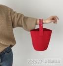 日韓chic簡約帆布水桶包休閒百搭小手拎挽包隨身便攜飯盒袋手機包『新佰數位屋』
