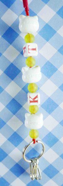 【震撼精品百貨】Hello Kitty 凱蒂貓~手機吊飾-白英文黃花