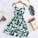沙灘洋裝 海邊度假印花吊帶連衣裙女2021夏季新款A字沙灘裙chic收腰蓬蓬裙 歐歐