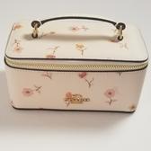 美國Coach 白色小花圖騰設計 經典金色馬車款式 化妝盒 最新上市 限量款