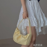 手提包小眾設計嫩黃色褶皺法棍包柔軟腋下包包女個性單肩手提包