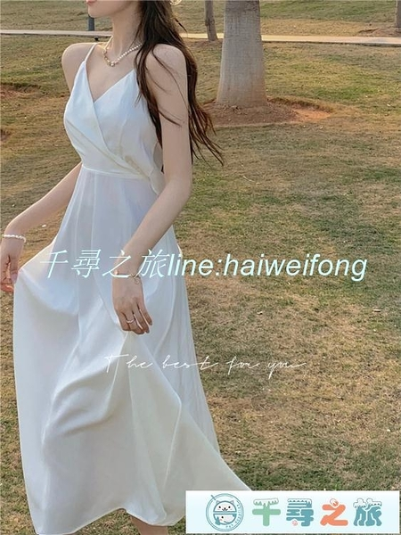 吊帶洋裝 吊帶連身裙女性感露背蝴蝶結白色中長裙夏季法式復古裙子 小天使【千尋之旅】