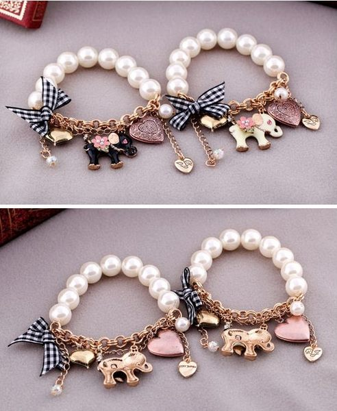 star 童話系列 -蝴蝶結珍珠小象女士手鏈 彈力串珠手環 .特價品 -C60