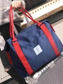 旅行袋子手提行李包單肩短途帆布旅行包女大容量斜挎收納包男