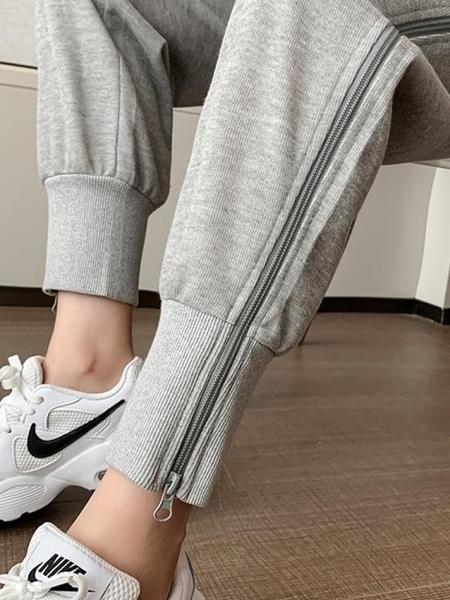 運動褲 運動褲子女春季新款韓版個性側邊拉鍊九分束腳哈倫褲休閒衛褲 快速出貨