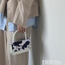 手提包 小眾設計奶牛紋毛毛鍊條斜背包2021新款少女復古翻蓋手提側背小包 【99免運】