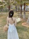 長款洋裝 白色露背蝴蝶結長裙子女裝2021夏季新款吊帶裙海邊度假氣質連衣裙 歐歐