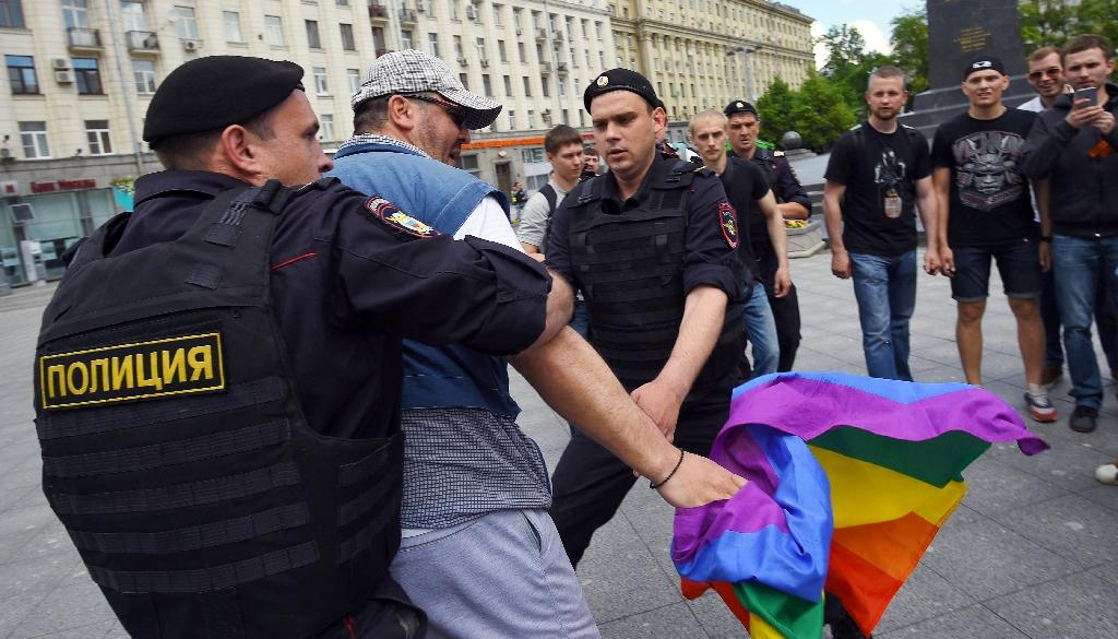 Russian riot policemen detain a gay and LGBT rights activist during an unauthorized gay rights rally in central Moscow on May 30, 2015