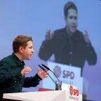 German Social Democrats give Merkel coalition a chance