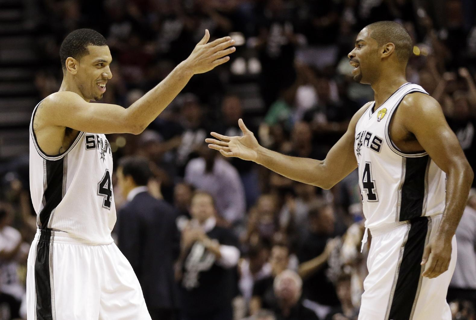 San Antonio Spurs' Danny Green, left, reacts with Gary Neal after scoring during the first half at Game 3 of the NBA Finals basketball series against the Miami Heat, Tuesday, June 11, 2013, in San Antonio. (AP Photo/Eric Gay)