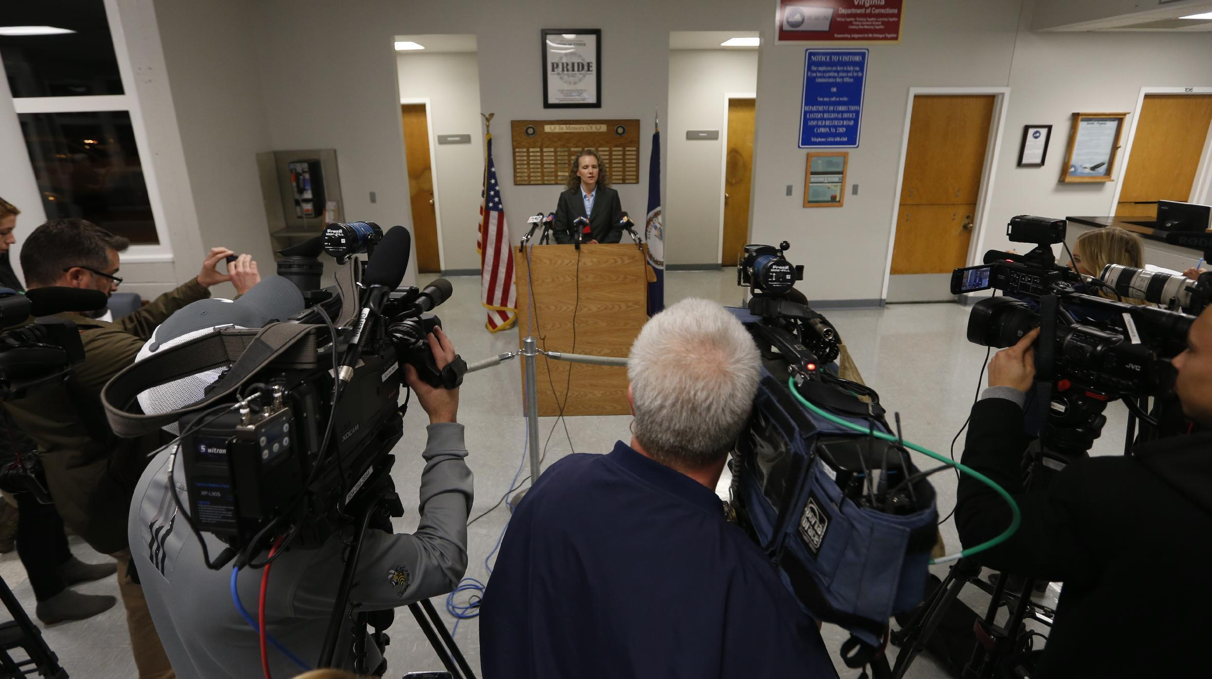 Virginia Department of Corrections spokesperson, Lisa Kinney, at podium, announces the execution of Ricky Gray at the Greensville Correctional Center in Jarratt, Va., Wednesday, Jan. 18, 2017. Gray who was convicted of killing a couple and their two young daughters in their Virginia home on New Year's Day 2006 was put to death Wednesday. (AP Photo/Steve Helber)