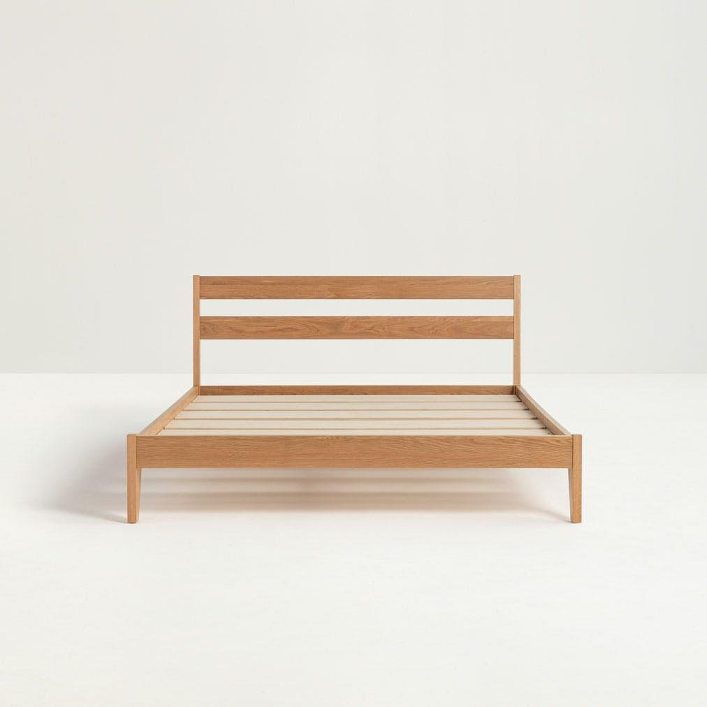 """<p>This wood frame is available in a walnut or an oak finish (pictured). Either finish will blend beautifully into a contemporary space. If you've been thinking about giving your bedroom an upgrade, this bed frame will definitely help you elevate your space.</p> <p><strong>Return Window:</strong> 100 days</p> <p><strong>Warranty:</strong> 12 years</p> <p><strong>Customer Review:</strong> """"Love, love, love this bed frame! My husband and I seek out USA-made products. This bed frame is just as pictured, the color and quality are terrific. Love the elegance and simplicity of it all. Very stable. No squeaks. Easy assembly. No complaints. We bought a queen size 11.5 inch Saatva mattress for it and it fits perfectly. We use it alone without a box spring and it is a perfect height for us.... The mattress is a perfect fit (and) seems like it will last us a long time."""" —<em>Jaime G.</em></p> $995, Tuft and Needle. <a href=""""https://www.tuftandneedle.com/frame/"""" rel=""""nofollow noopener"""" target=""""_blank"""" data-ylk=""""slk:Get it now!"""" class=""""link rapid-noclick-resp"""">Get it now!</a>"""