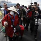 Hundreds of passengers leave coronavirus-hit cruise ship as quarantine ends