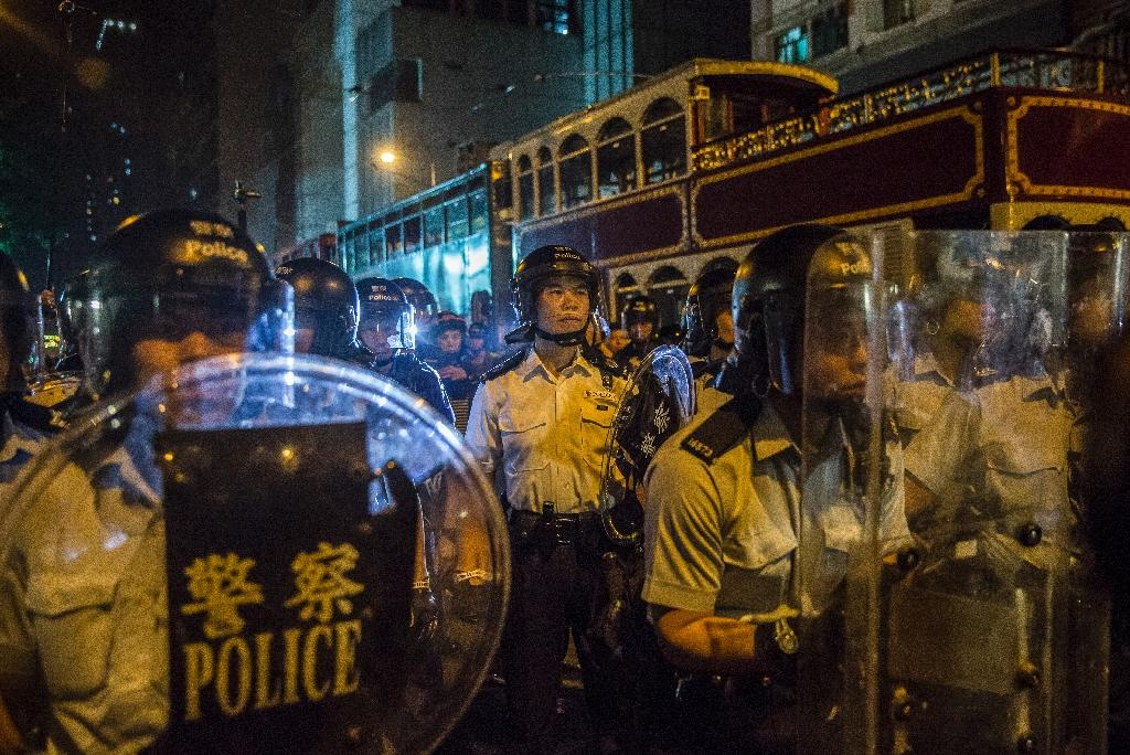Riot police form a line during a political protest in Hong Kong, one of many during the term of Chief Executive Leung Chun-ying (AFP Photo/ISAAC LAWRENCE)