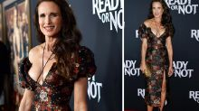 Andie MacDowell, 61, rocks a thigh-high split and plunging neckline