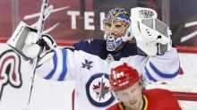 Jets clinch playoff spot, beat Flames 4-0 to end skid