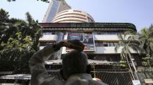 Sensex, Nifty flat amid global growth worries; Reliance Industries up