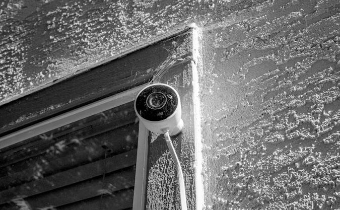 Nest surveillance camera from Google installed on the exterior of a suburban home atop a window in San Ramon, California, August 11, 2020. (Photo by Smith Collection/Gado/Getty Images)