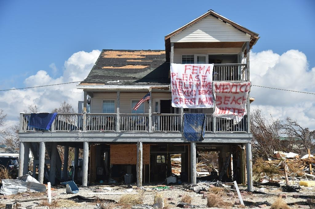 "A sign reads ""FEMA please help make Mexico Beach great again"" in a coastal Florida town devastated by Hurricane Michael (AFP Photo/HECTOR RETAMAL)"