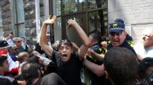 LGBT+ campaigners in Georgia call off pride march after office attack