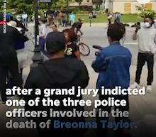 Seattle officer on leave after video shows cop rolling bicycle over protester's head