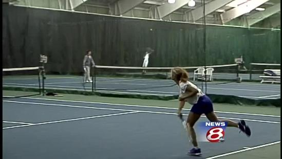 Defending champions win opening matches at high school tennis tournament
