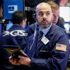Wall Street eases as oil prices, General Electric fall