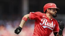 Suárez, surging Reds sweep Rockies, move back over .500