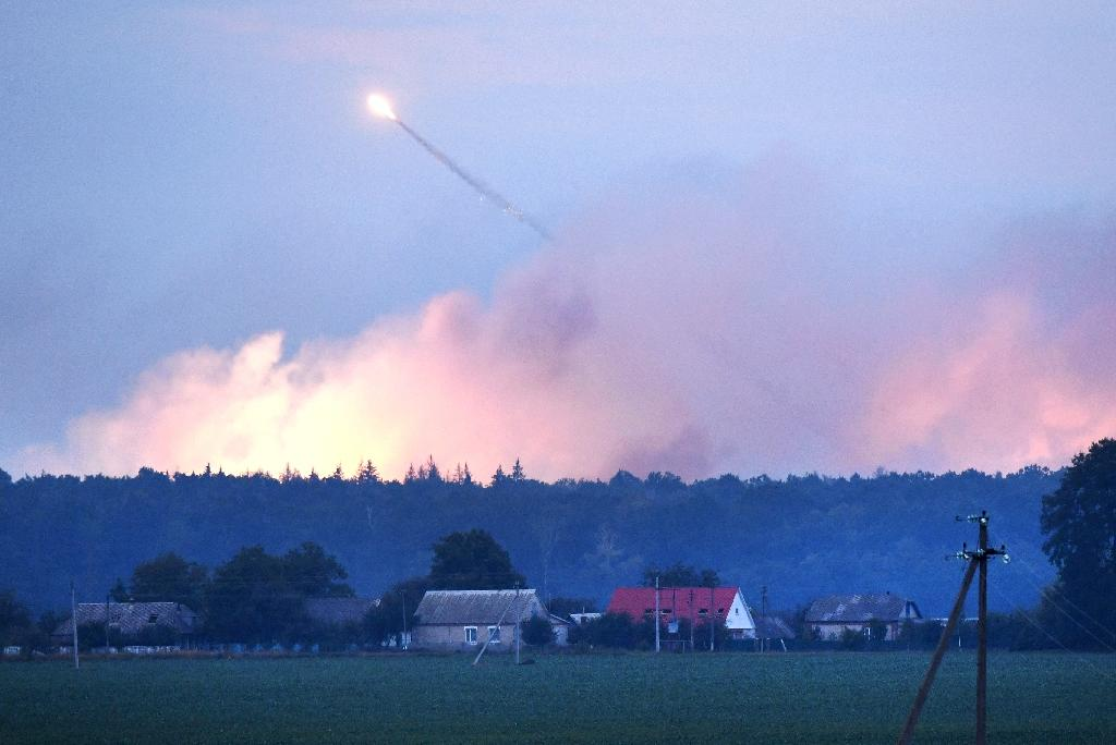 Police said the flames caused artillery shells at the facility to explode one after the other. (AFP Photo/Sergei SUPINSKY)
