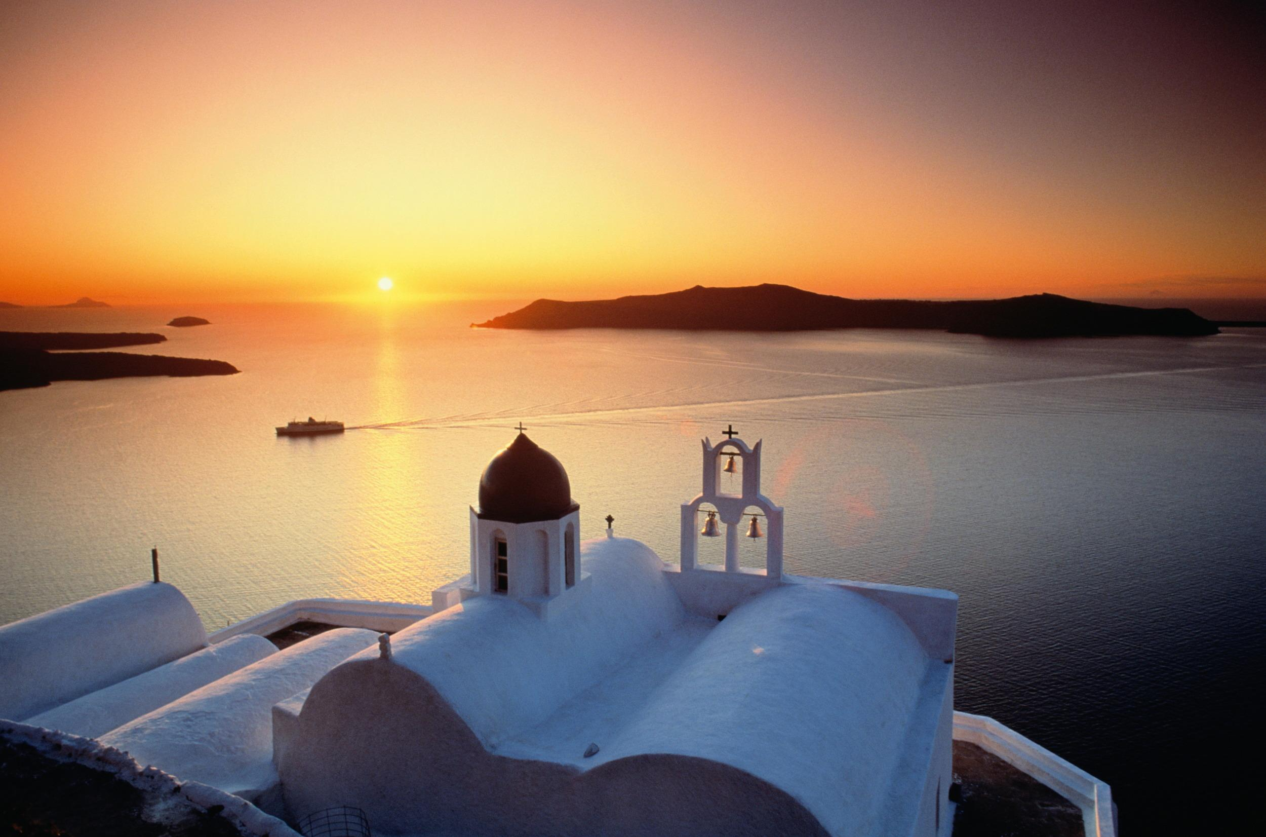 """<p><span style=""""font-family:helvetica, arial;font-size:16px;background-color:rgb(255, 255, 255);"""">Spellbinding sunsets await you on the isle of Santorini, where you can wine and dine yourselves in a cliffside restaurant, allowing the spectacular views to enchant your senses. Regarded by many as one of the most beautiful locations on earth to witness the sun setting over the sea, visitors flock to take advantage of the sublime views from the cliff towns all year round. From the quintessentially Greek whitewashed churches with bright blue-domes, to quaint little towns like Oia, Santorini is perhaps the most popular island in Greece for romance, considered by newlyweds as a photo-perfect backdrop to the dream honeymoon.</span><span style=""""font-family:helvetica, arial;font-size:16px;"""">Tip: Best time to visit is October when its more peaceful and the water is warm.</span></p>"""