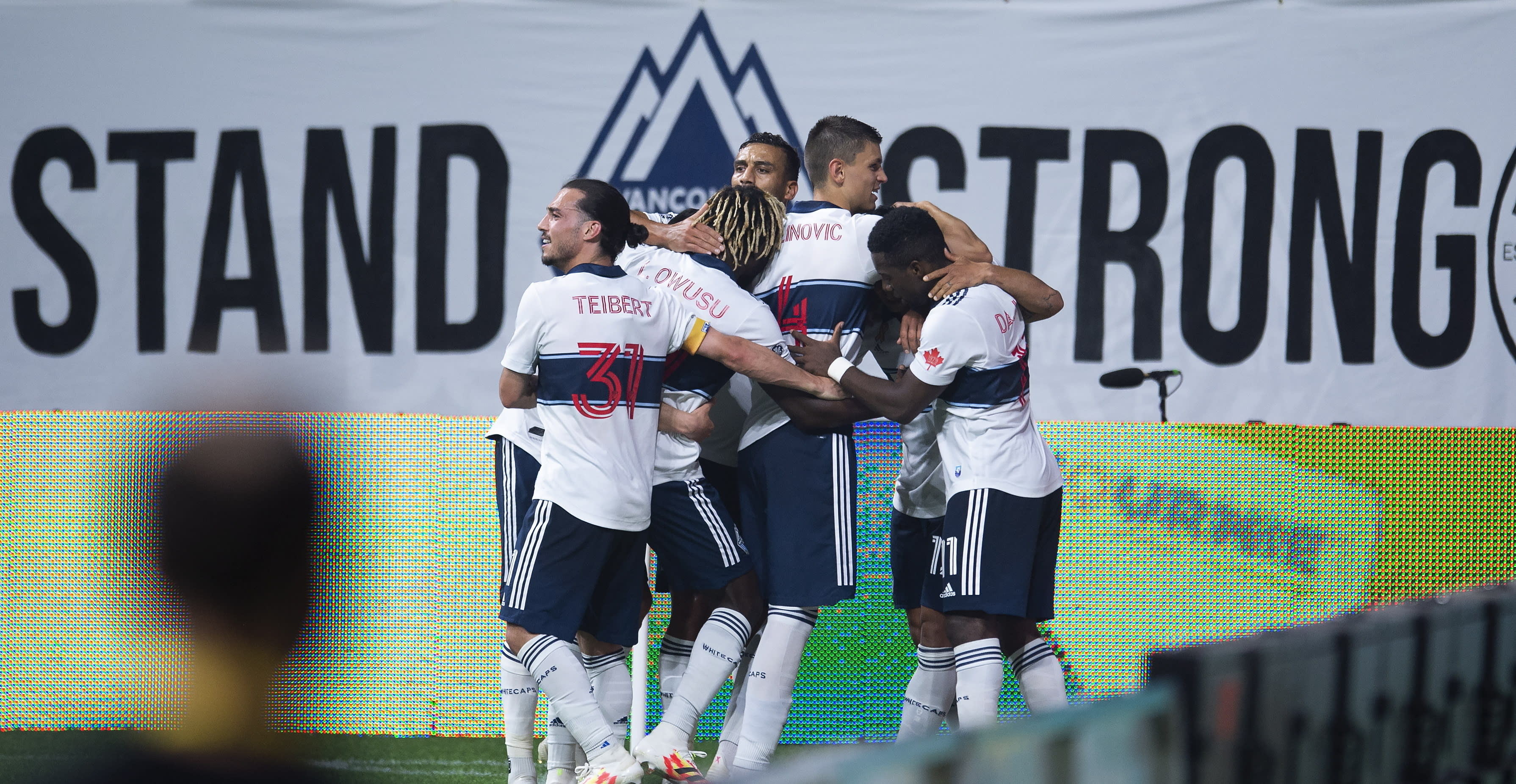 The Vancouver Whitecaps celebrate Fredy Montero's goal against the Montreal Impact during second half MLS soccer action in Vancouver, B.C. Wednesday, September, 16, 2020. THE CANADIAN PRESS/Jonathan Hayward/The Canadian Press via AP)during the second half of an MLS soccer match Wednesday, Sept. 16, 2020, in Vancouver, British Columbia. (Jonathan Hayward/The Canadian Press via AP)